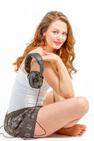 Young woman joyfully listens to audio Royalty Free Stock Photos