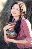 Young woman with jug of milk Stock Photography