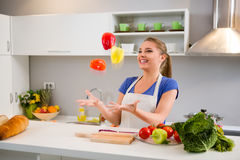 Young woman  juggle with vegetables Stock Image