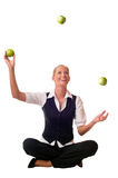Young woman juggles an apple Royalty Free Stock Images