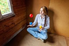 Young woman juggling Stock Photo