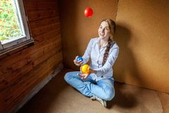 Young woman juggling Royalty Free Stock Image