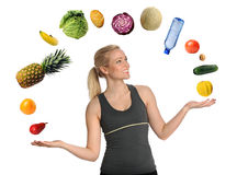 Young Woman Juggling Fruits and Vegetables Stock Image