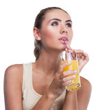 Young woman with juice on white backg Stock Photo