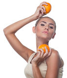 Young woman with juice on white backg Royalty Free Stock Photos
