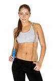 Young Woman with Jump Rope Around Neck. Beautiful Young Woman with Jump Rope Around Neck Royalty Free Stock Photography