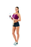 Young woman with jump rope and bottle with water Royalty Free Stock Photos