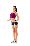 Young woman with  jump rope round  waist stand sideways in sport Stock Photos