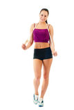Young woman with jump rope on shoulder  in sportswear Royalty Free Stock Photos