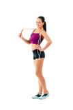 Young woman with jump rope on shoulder stand sideways in sportsw Royalty Free Stock Photography