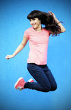 Young woman jumping. Image of a happy young woman jumping Stock Photo