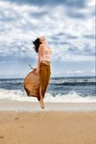 Young woman is jumping Royalty Free Stock Photos