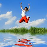 Young woman is jumping Royalty Free Stock Photo