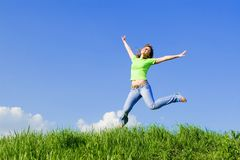 Young woman is jumping Royalty Free Stock Images