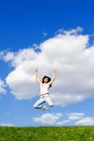 Young woman is jumping Stock Photography