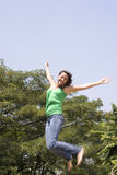Young woman jumping Stock Photography