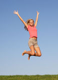 Young woman jumping in air stock images