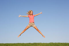 Young woman jumping in air Royalty Free Stock Image
