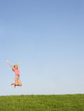Young woman jumping in air Royalty Free Stock Images
