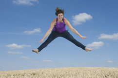 Young woman jumping in the air Royalty Free Stock Photography