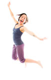 Young woman jumping in air and laughing Royalty Free Stock Photos