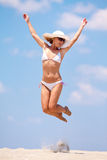Young woman jumping on a beach Royalty Free Stock Photos