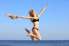Young woman jumping on beach fit sporty girl Royalty Free Stock Photography