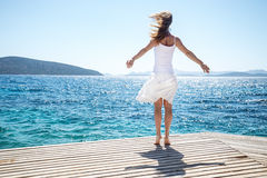 Young woman jumping on the beach Royalty Free Stock Photo