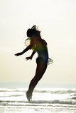 Young woman jumping on the beach in summer Stock Photo