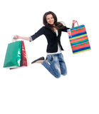 Young woman  jumping with color bags Royalty Free Stock Images