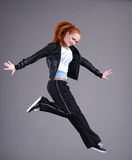Young woman jumping and dancing Royalty Free Stock Photo