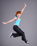 Young woman jumping and dancing Stock Images