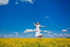 Young woman jumping on field Royalty Free Stock Images