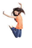 Young Woman Jumping. Full body portrait of asian american dancer jumping in studio on white background wearing casual jeans and colorful tank top Royalty Free Stock Image