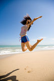 Young woman jumping happily. Young woman leaping joyfully in the air Stock Photography