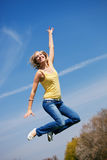Young woman jumping high Stock Images