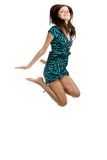 Young woman jumping high in the air with a big smi Royalty Free Stock Images