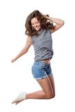 Young woman is jumping stock photos