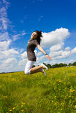 Young woman jumping for joy in the air. A young woman jumping for joy in the air Stock Image