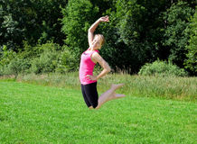 Young woman jumping Stock Image