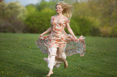 Young woman jumping  on meadow Royalty Free Stock Photo