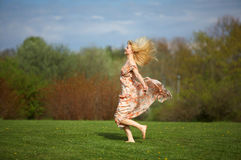 Young woman jumping  on meadow Royalty Free Stock Images