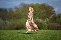 Young woman jumping  on meadow Royalty Free Stock Photos