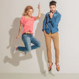 Young woman jumping next to her lover Stock Images