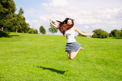 Young woman jumping outdoor Royalty Free Stock Images