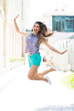 Young woman jumping Royalty Free Stock Images