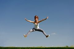 Young woman jumping outside Stock Photo