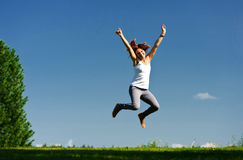 Young woman jumping outside Stock Photos