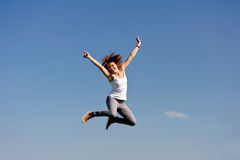 Young woman jumping outside Stock Images