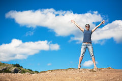 Young woman jumping over the blue sky Stock Image